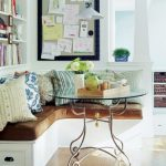 Corner Dining Nook With White Wooden Bench, Brown Cushion, Pillows, Glass Top Table, Messages On Board, Bookshelves
