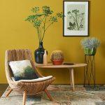 Corner, Rug, Rattan Curvy Chair, Mustard Wall, Wooden Coffee Table, Plants