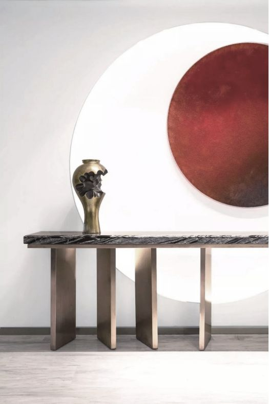 cosole table with glossy metal material, upside down vase