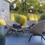 Curvy Round Rattan Chairs With Brown Color, Black Cushion And Pillows, Round Coffee Table