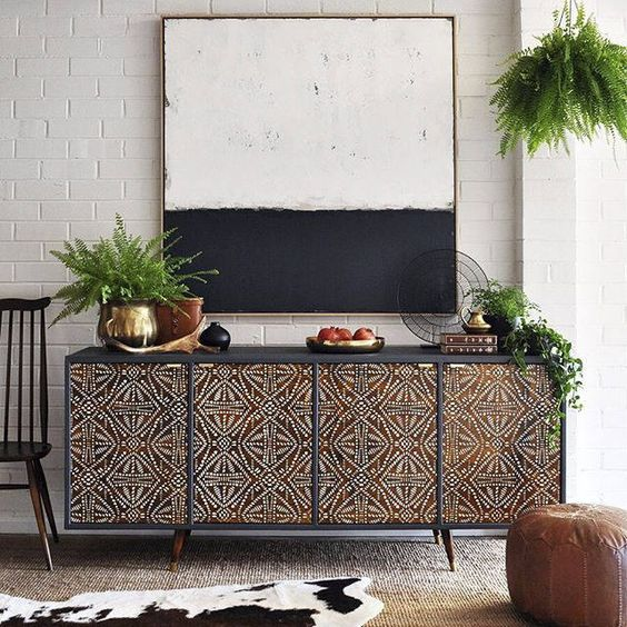 dark brown cabinet with tribal pattern on the front cover