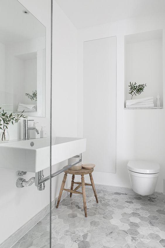 different grey colors in hexagonal tiles in bathroom