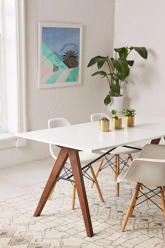 dining area, white wooden floor, white rug, white midcentury modern chairs, wooden legged table with white top, white wall