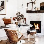 Dining Nook, Wooden Floor, White Marble Tulip Table. White Bench With Gery Cushion, Pillows, Rattan Chairs, Brown Leather Stool, White Marble Fireplace, White Wall, Pendant