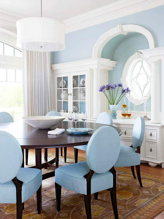 dining room, brown rug, light blue chairs, dark roud table, blue wall, white pendant