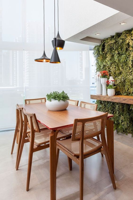 dining room, white floor tiles, large windows shaded curtain, black pendant, plants vertically on the wall, wooden shelves, white wall