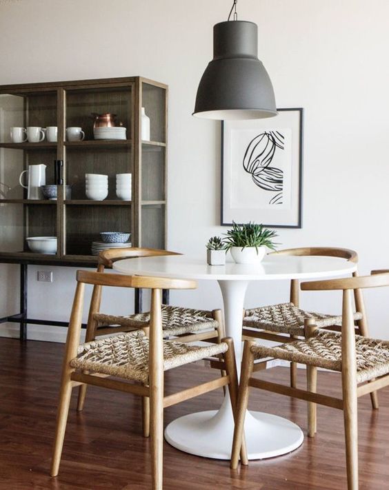 dining room, white small round dining table, wooden chair with rattan cushion, wooden floor