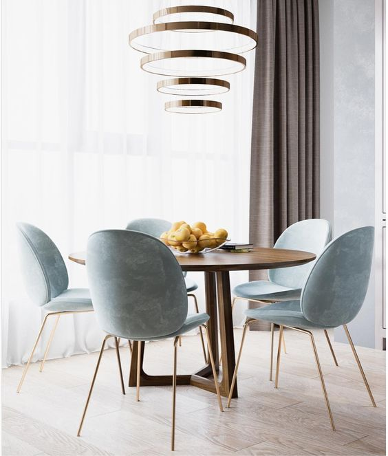 dining room, wooden floor, wooden round table, light blue chairs with golden legs, chandelier