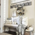 Entrance With Wooden Bench With White Cushion, Pillows, Coat Racks, Wooden Basket, Wooden Message Board