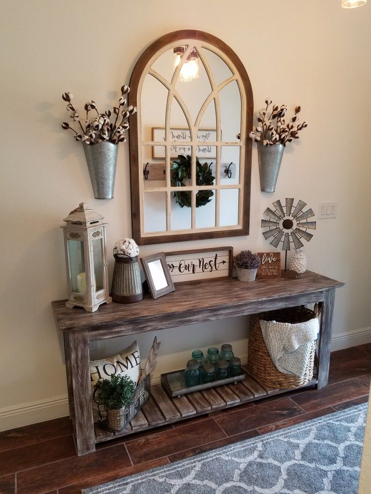 entrance with wooden table with shelf, dry plants, baskets, decorations