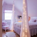 Fairy Lights Hung On The Bed Curtains