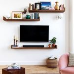 Floating TV With Floating Shelves Under For Player, Shelves Above For Decorations And Books