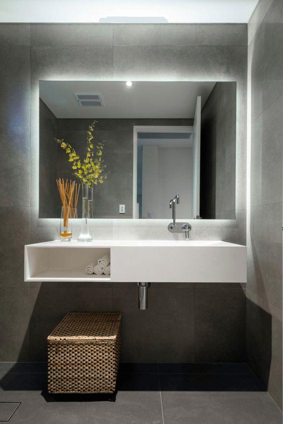 floating frameless sqare mirror on grey walls