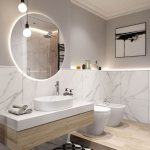 Floating Framless Round Bathroom Mirror On White Bathroom With White Sink Vanity