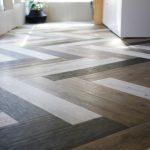 Floor With Wood Pattern Tiles In Herringbone Pattern