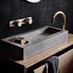 Grey Sink On Wooden Vanity Cabinet, Dark Wall, Golden Faucet