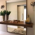 Hallway With Rectangular Frameless Mirror, Wooden Shelves With Small Drawer, Decoration, Vase, Wall Decoration