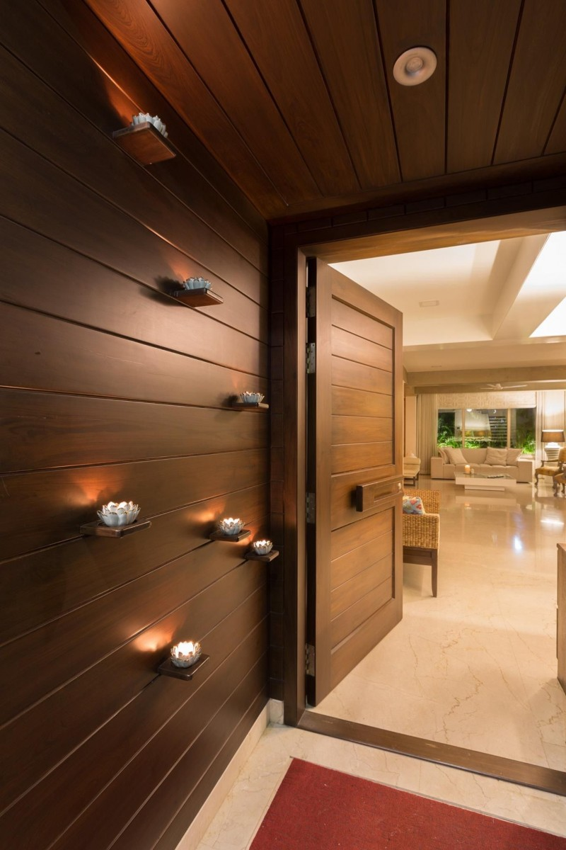 hallway with wooden wall and ceiling, floating small shelves with lotus shaped lamps