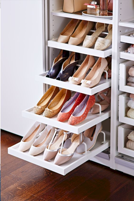 hidden sliding shoe racks on the cupboard