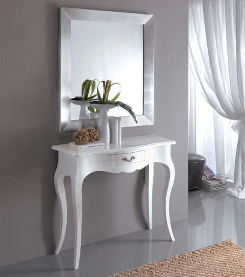 high white wooden console table with curve and details on the middle front, curvy legs, silver square mirror