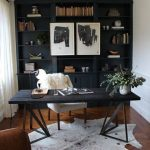 Home Office With Wooden Floor, Animal Patter Rug, Dark Thin Table, White Chair, Dark Shelves, Curtain