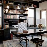 Home Office With Wooden Floor, Rug, Black Wooden Table With Stool, White High Back Chair, Black Bookshelves