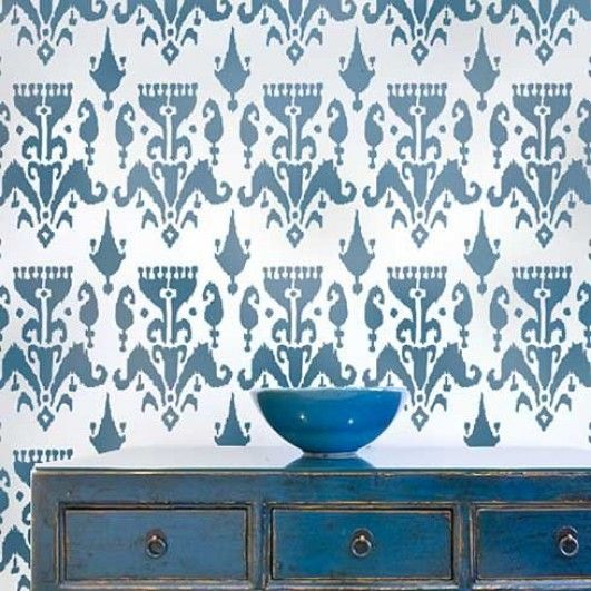 ikat pattern on the wllpaper with blue cabinet