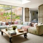 Indoor Seating Cushions Colorful Cushions Wheeled Wooden Coffee Table Colorful Pillows Glass Floor To Ceiling Windows Skylight
