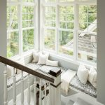 Indoor Seating Cushions Stairscase Stairs Railing White Framed Glass Windows Patterned Cushions White Throw White Throw Pillows Wall Sconces