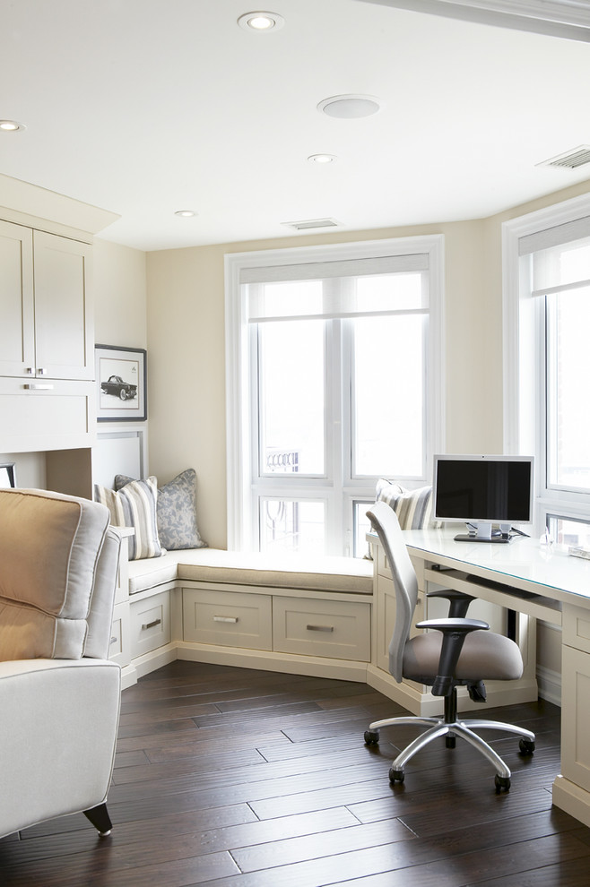 indoor seating cushions white glass windows white blinds office chair built in desk drawers cabinet beige armchair artwork pillows
