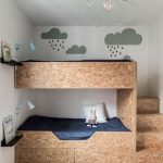 Kids Bunk Beds With Boxe Shapes Made From Woode Fibers, Stairs, Cabinets, In A Bedroom With Wooden Floor, Rug, Shelves And Lamp For Each Bed, Pendant,