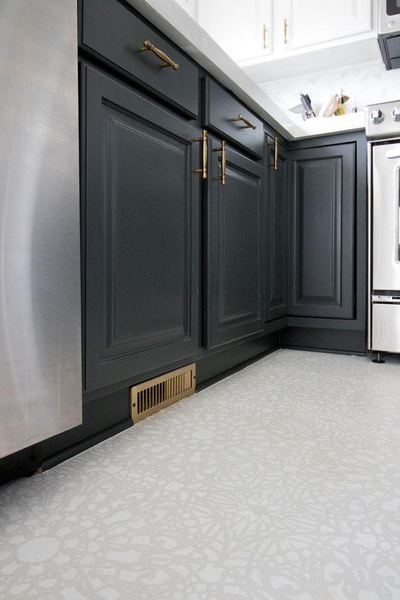 kitchen floor with white patterned linoleum flooring