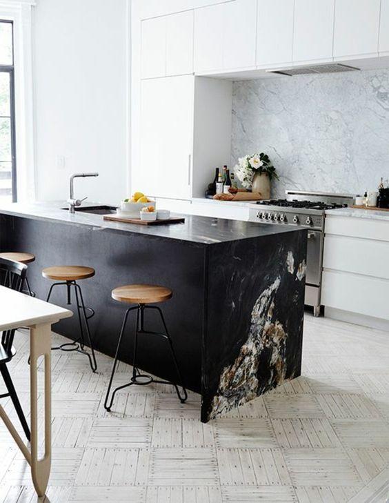 kitchen with black marble top on the black island, stool, white marble bacsplash, white cabinet, white light tiles