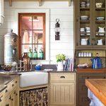 Kitchen With Brown Wooden Floor, White Wooden Wall, Brown Wooden Cabinet, Larder, White Ceramic Sink, Dark Kitchen Top