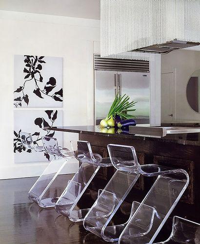 kitchen with dark wooden flooring, dark wooden kitchen top, acrylic bar stools