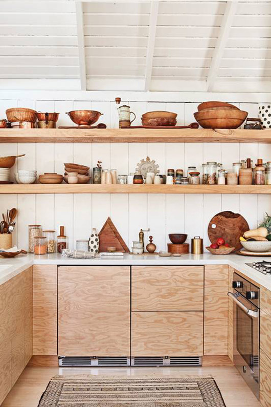 kitchen with glossy floor, light brown wooden cabinet uner white top, light brown wooden open shelves