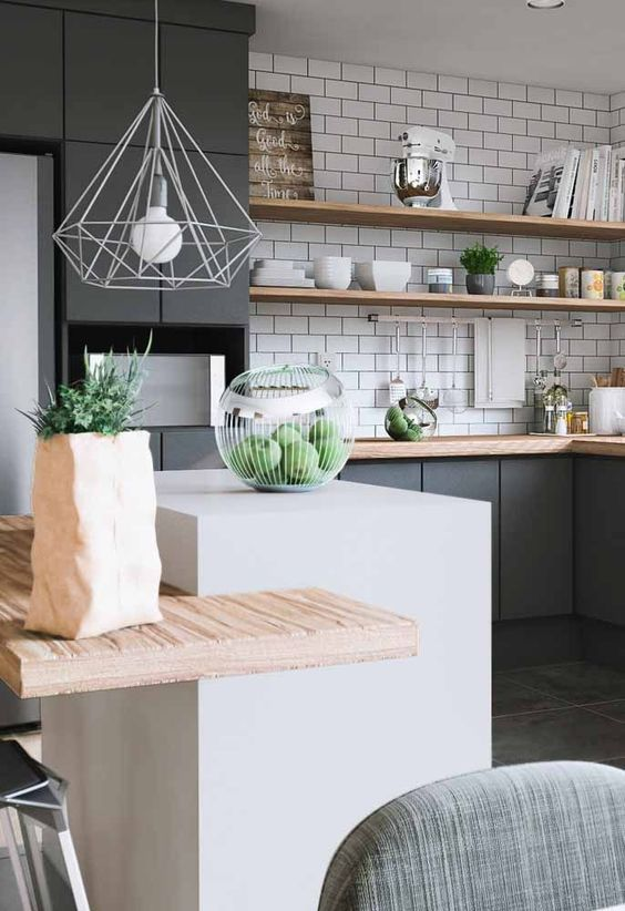 kitchen with grey cabinet, white small sialnd, wooden kitchen top, wooden shelves on white tiles, white pendant