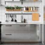 Kitchen With Metal Cabinet, White Tiles On The Wall, Metal Rail With Hooks, Shelves