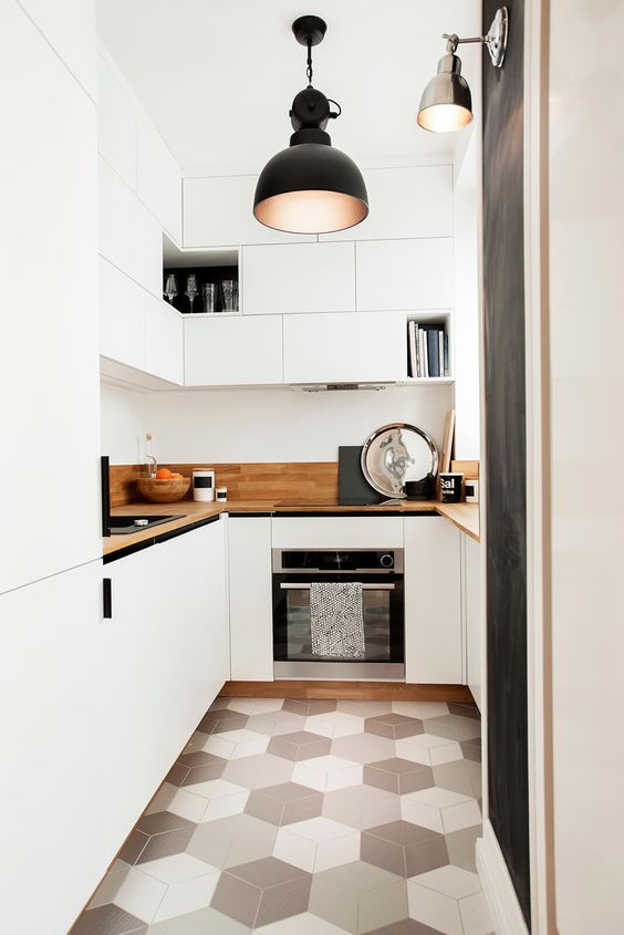 kitchen with white cabinet under and on top wooden kitchen top, light grey hexagonal tiles, black modern pendant