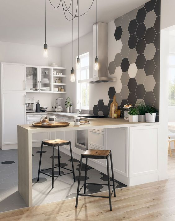 kitchen with white cabinet, white counter top, white cupboards, shelves, wall, hexagon tilse on the backsplash side and floor, pendant