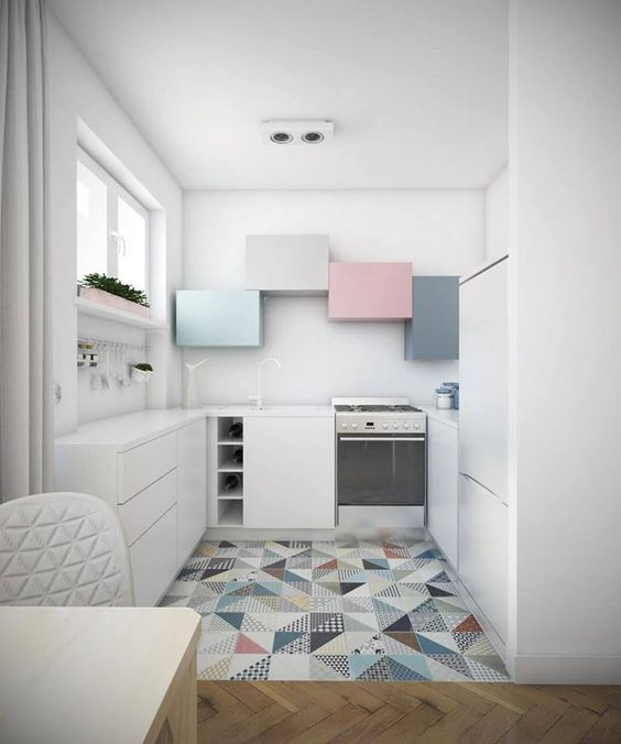 kitchen with white cabinet, white kitchen top, colorful patterned tiles, soft colored cabinets on top, plants on the window