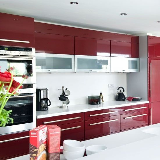 kitchen with white island top, white counter top, red cabinet all over