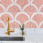 Kitchen With White Marble Top, Grey Cabinet, Golden Faucet, Pink Terrazzo Tiles With Fish Scales Motive