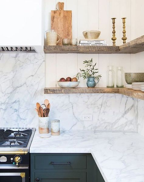 kitchen with white wall, grey cabinet, marble countertop and backsplash, wooden open shelves