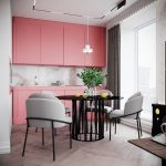 Kitchen With Wooden Chevron Pattern, Pink Cabinet On Top And Bottom, Marble Backsplash, White Wall, Statement Ceiling With White Pendant, Black Round Dining Table With Grey Chairs