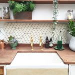 Kitchen With Wooden Counter Top, White Sink, White Geometric Tiles On Backsplash, Wooden Shelves