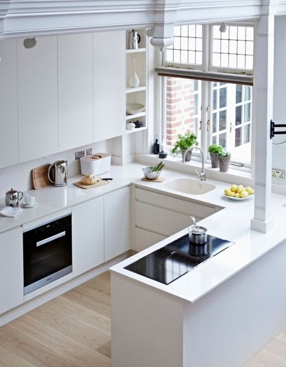 kitchen with wooden floor, white cabinet, white counter top, white floating cabinet, white shelves, white sink, windows
