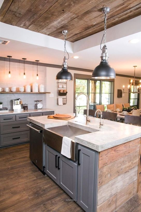 kitchen with wooden floor, wooden island with white ceramic top, silver sink, grey wooden cabinet, open shelves, black pendant