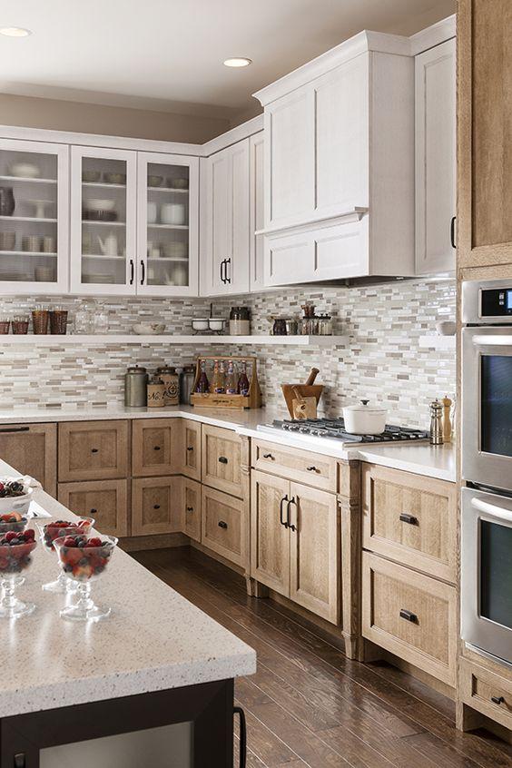 kitchen with wooden flooring, light brown wood cabinet with handles, white grey backsplash, white wooden floatin cabinet, island with white top