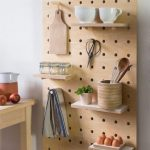 Kitchen With Wooden Pegboard With Shelves